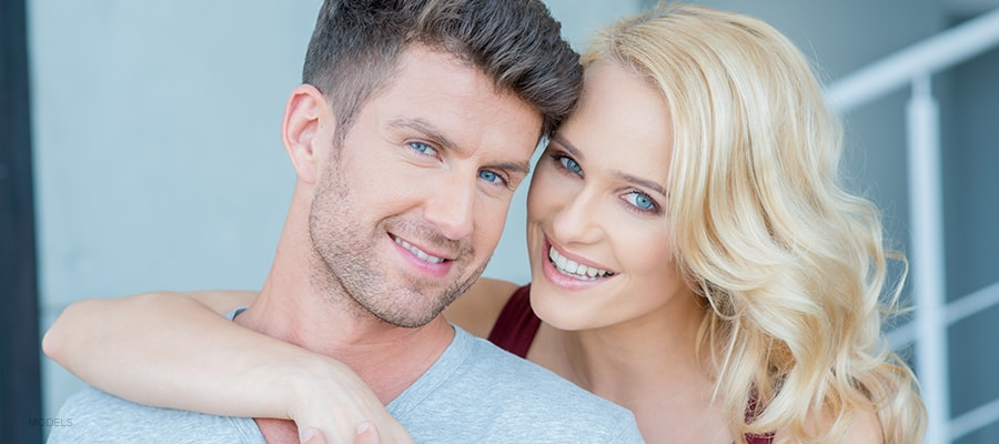 Good-looking Middle Aged Couple Smiling and Embracing