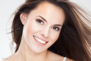 Smiling Model with Brown Hair and Eyes